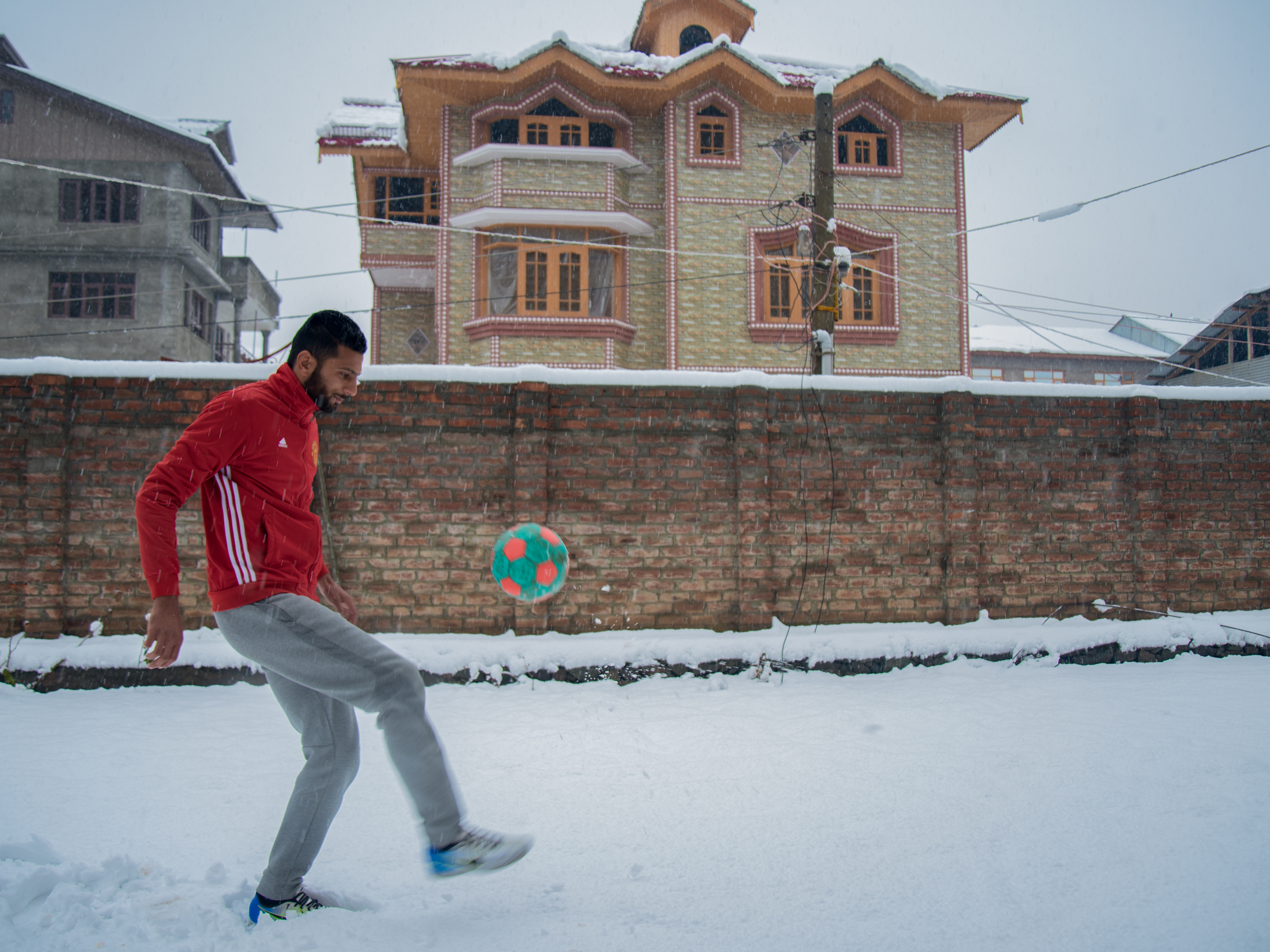 Muhammad Hammad 21 Kicks A Soccer Ball Outside His Family Home In Srinagar Hammad Plays Center Back For Real Kashmir As It Vies For The Top Title In Indian Professional Soccer Wjct