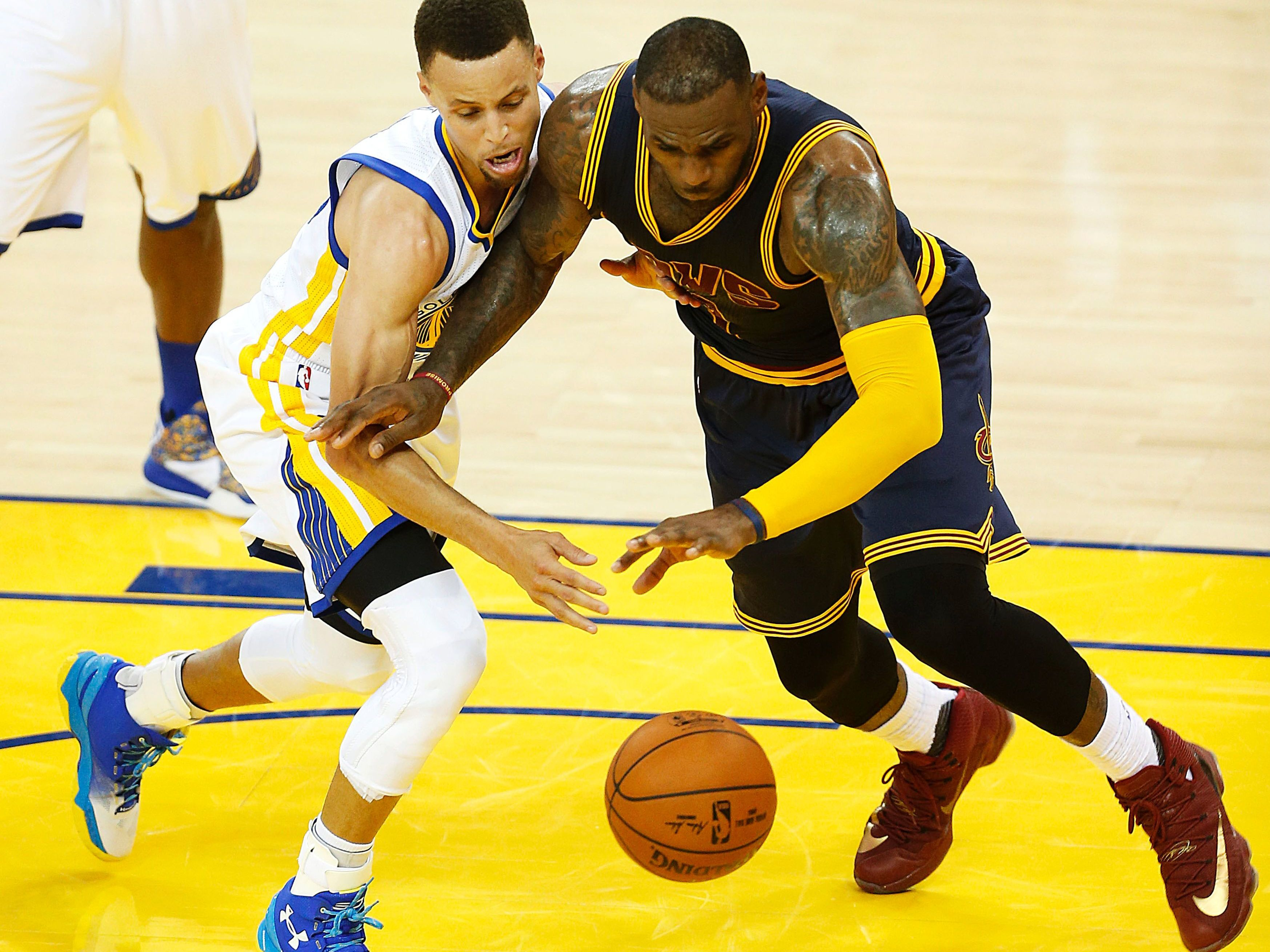6af292a674b0 Golden State Warriors guard Stephen Curry (left) and then-Cleveland  Cavaliers forward LeBron James scramble for a loose ball during game 1 of  the 2016 NBA ...