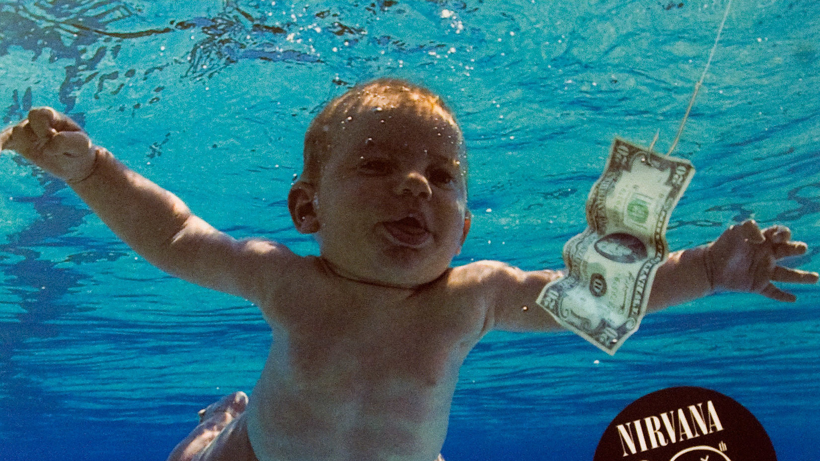 """Featured image for """"Man Photographed As A Baby On 'Nevermind' Cover Sues Nirvana For Sexual Exploitation"""""""