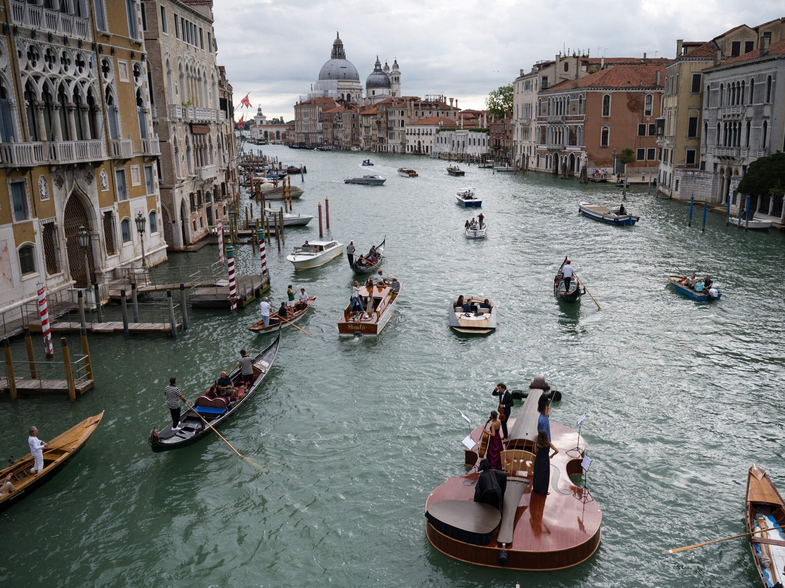 """Featured image for """"Watch A Massive Violin Transport Musicians Down Venice's Grand Canal"""""""
